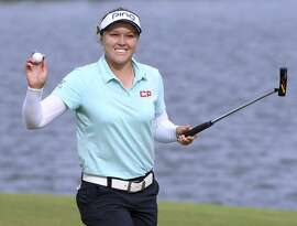 Brooke Henderson of Canada celebrates her final putt and a four shot victory on the 18th green to win the LPGA LOTTE Championship at the Ko Olina Golf Club on April 14, 2018 in Kapolei, Hawaii.