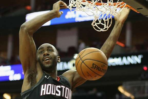 HOUSTON, TX - MARCH 22:  Luc Mbah a Moute #12 of the Houston Rockets dunks against the Detroit Pistons at Toyota Center on March 22, 2018 in Houston, Texas. NOTE TO USER: User expressly acknowledges and agrees that, by downloading and or using this photograph, User is consenting to the terms and conditions of the Getty Images License Agreement.  (Photo by Bob Levey/Getty Images)