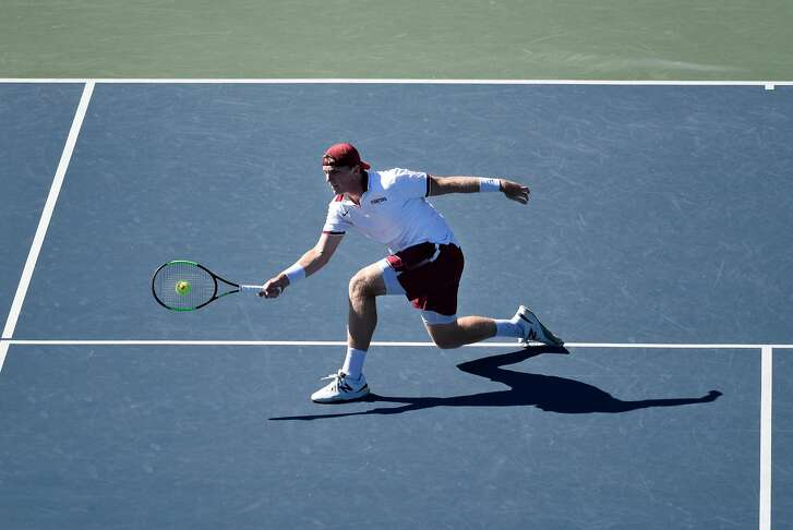 Stanford's Tom Fawcett hits a return during his singles match against Thomas Laurent of Oregon, at Stanford University in Stanford, CA, on Friday April 20, 2018.