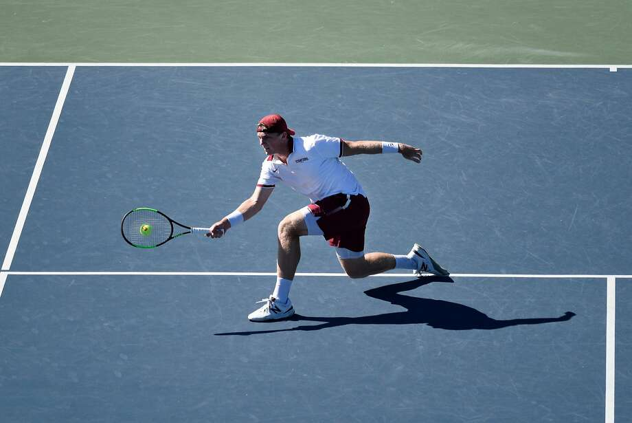 Stanford's Tom Fawcett hits a return during his singles match against Thomas Laurent of Oregon, at Stanford University in Stanford, CA, on Friday April 20, 2018. Photo: Michael Short / Special To The Chronicle