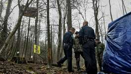 "State and local police, who are waiting to arrest Theresa ""Red"" Terry, stand near her platform in Roanoke County, Virginia, where she is protesting the approach of the Mountain Valley Pipeline along with her daughter, Theresa Minor Terry. Must credit: Washington Post photo by Michael S. Williamson"