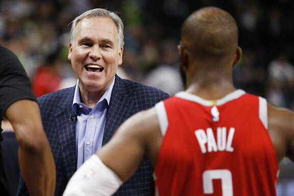 The positive attitude Rockets coach Mike D'Antoni, left, brings to the team is appreciated by the players.