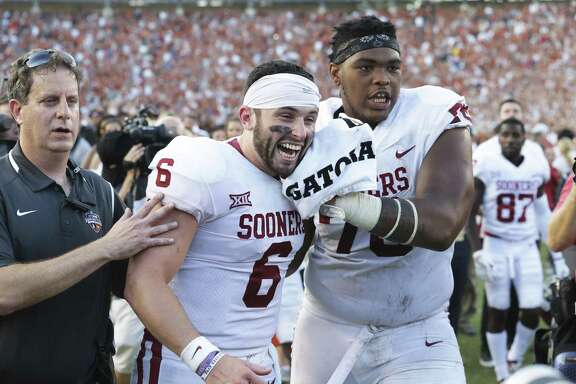 Oklahoma offensive tackle Orlando Brown, right, could still be available in the third round of the NFL draft.