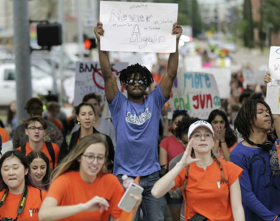 High school students walk out of class during the Houston Youth Walkout on Friday April 20. The students walked from Carnagie Vanguard High School in Montrose to Houston City Hall to protest against gun violence. Photo: Elizabeth Conley, MBO / Associated Press / ' 2018 Houston Chronicle