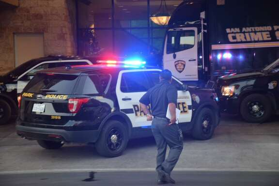 Police respond to officer-involved shooting Tuesday at the Embassy Suites hotel in downtown San Antonio. Authorities responded to the hotel around 6:40 a.m. in the 100 block of East Houston Street.