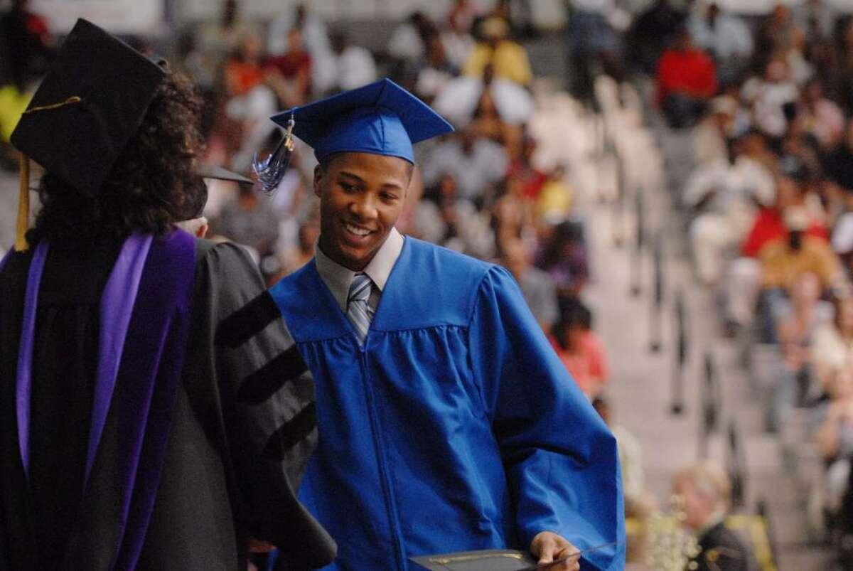 Albany High School graduate Jamar Bryan receives the Albany Board of Education Comprehensive Scholarship for Business. (Paul Buckowski / Times Union)