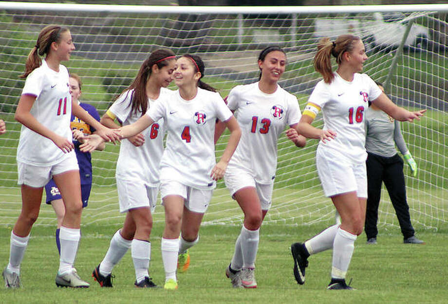 Members of the Roxana Shells soccer team celebrate a goal in their game against Civic Memorial Monday at Wood River. From left are Macie Lucas, MyKala Rosales, Alyssa Mendoza, Brynn Huddleston and Emma Lucas. Roxana is seeded No. 3 in sub-sectional A of the Columbia Class 1A Sectional and will begin postseason action May 9 against host and No. 7 seed Breese Central in the Breese Central Regional Tourney. Photo:       Pete Hayes | The Telegraph