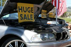 NOVATO, CA - MARCH 20:  Sale signs sit on a used cars at Novato Ford March 20, 2009 in Novato, California. As the economy worsens and new car sales continue to fall, sales of used cars are up 3.1% in February compared to one year ago.  (Photo by Justin Sullivan/Getty Images)