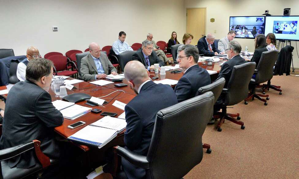 Executive director, Seth Agata, left, and members of the New York State Joint Commission on Public Ethics during a meeting Tuesday April 24, 2018 in Albany, NY. (John Carl D'Annibale/Times Union)