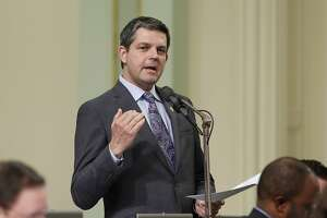 Assemblyman Jim Wood, D-Healdsburg, urges lawmakers to approve his bill to increase the minimum age for tobacco sale to 21, at the Capitol, Thursday, March 3, 2016, in Sacramento, Calif. The bill was approved on a 46-26 vote and sent to the Senate. The measure was part of a package of bills aimed at restricting access to tobacco.(AP Photo/Rich Pedroncelli)