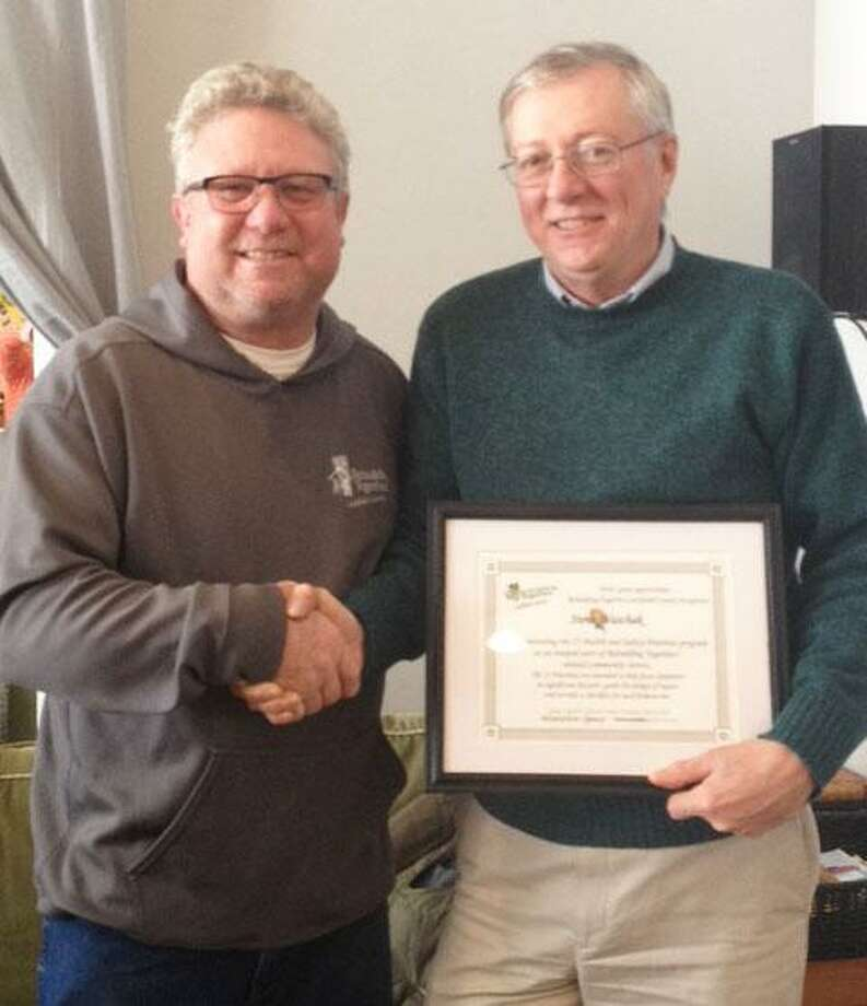 Mike Bogues, chairman of the board of directors for Rebuilding Together Litchfield Country, left, presents Steve Waschak of New Milford with a certificate for being the recipient of this years Employee of the Year Award. Photo: Courtesy Of Rebuilding Together Litchfield County / The News-Times Contributed