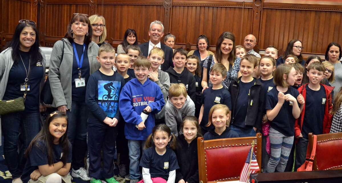 State Representative Richard Smith (R-108th) recently joined State Senator Michael McLachlan (R-24th) in welcoming a third-grade class from Sherman School, as well as their teachers and parent chaperones to the State Capitol. After touring the historic Capitol building, the third-graders were officially announced on the floor of the House by Rep. Smith during a scheduled House session. Then, Sen. McLachlan welcomed them to the Senate chamber.