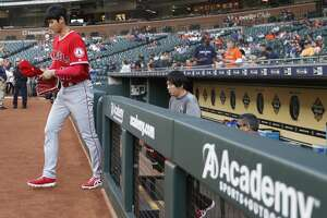 Los Angeles Angels starting pitcher Shohei Ohtani comes out of the dugout to warm up before the start of an MLB game at Minute Maid Park, Tuesday, April 24, 2018, in Houston. ( Karen Warren  / Houston Chronicle )