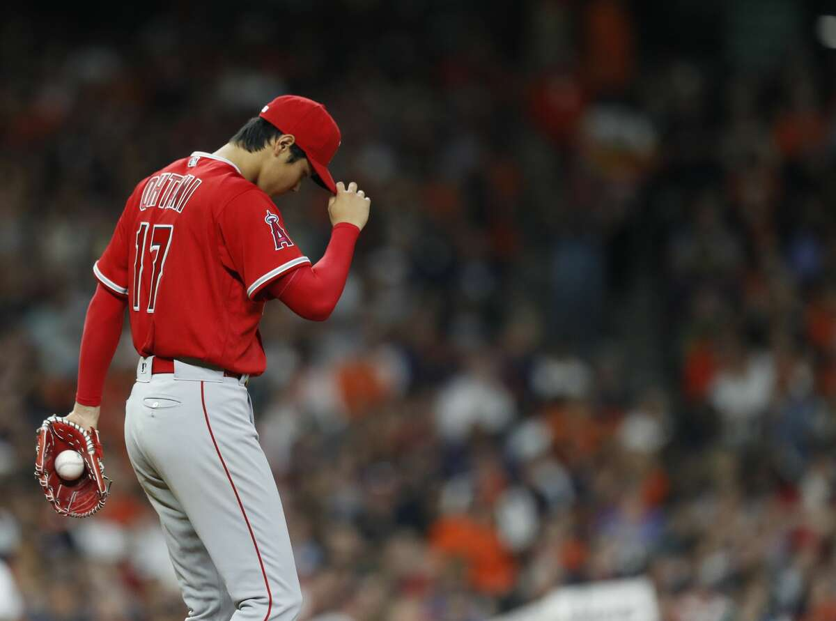 Los Angeles Angels starting pitcher Shohei Ohtani (17) reacts after giving up a walk to Houston Astros Carlos Correa (1) during the third inning of an MLB game at Minute Maid Park, Tuesday, April 24, 2018, in Houston. ( Karen Warren / Houston Chronicle )