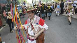 Huichol Shaman Christopher Wallace leads a procession Tuesday to kick off the opening of Night in Old San Antonio during Fiesta. Hosted by the San Antonio Conservation Society, thousands of eager partygoers flocked to La Villita for food, music and all-around revelry. Many came to NIOSA to see others who donned the ever-outlandish Fiesta hats as they strolled the grounds of La Villita. Proceeds from the event benefit the various projects by the Conservation Society.