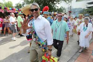 FILE PHOTO — Mayor Ron Nirenberg takes part in the parade to kick off Night in Old San Antonio (NIOSA) on its first night of celebrations during Fiesta Week on Tuesday, Apr. 24, 2018. Hosted by the San Antonio Conservation Society, thousands of eager party-goers flocked to La Villita for food, music and all-around revelry. Many came also went to NIOSA to see others who donned the ever-outlandish Fiesta hats as they strolled the grounds of La Villita. Proceeds from the event benefit the various projects by the conservation society. (Kin Man Hui/San Antonio Express-News)