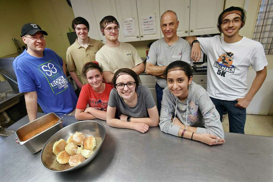 In this file photo, students in the SkillsUSA program at Platt Tech in Milford, Zoe Paskiewicz, Samantha Winkel and Andreina Barajas front row, left to right, and history teacher and Beth El cooridinator Dan Quinn, Trevor White, William Bassett, Skills USA advisor Kirk Stankiewicz and Carlos Texidor, back row, left to right, photographed in April 2018, after preparing and serving the homeless at the Beth El Center in Milford. The students and their moderators prepare and serve meals to the homeless twice a week during the school year and once a week during the summer. Photo: Catherine Avalone, Hearst Connecticut Media / New Haven Register
