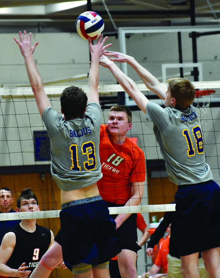 Edwardsville's Cal Werths goes up for a kill during the first game at O'Fallon.