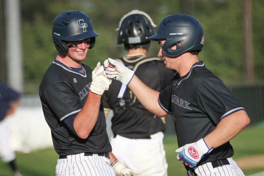 College Park's Luke Trahan (7) and Luke Repka (6) celebrate during the baseball game against Conroe on Tuesday, April 24, 2018, at Conroe High School. (Michael Minasi / Houston Chronicle) Photo: Michael Minasi, Staff Photographer / © 2018 Houston Chronicle