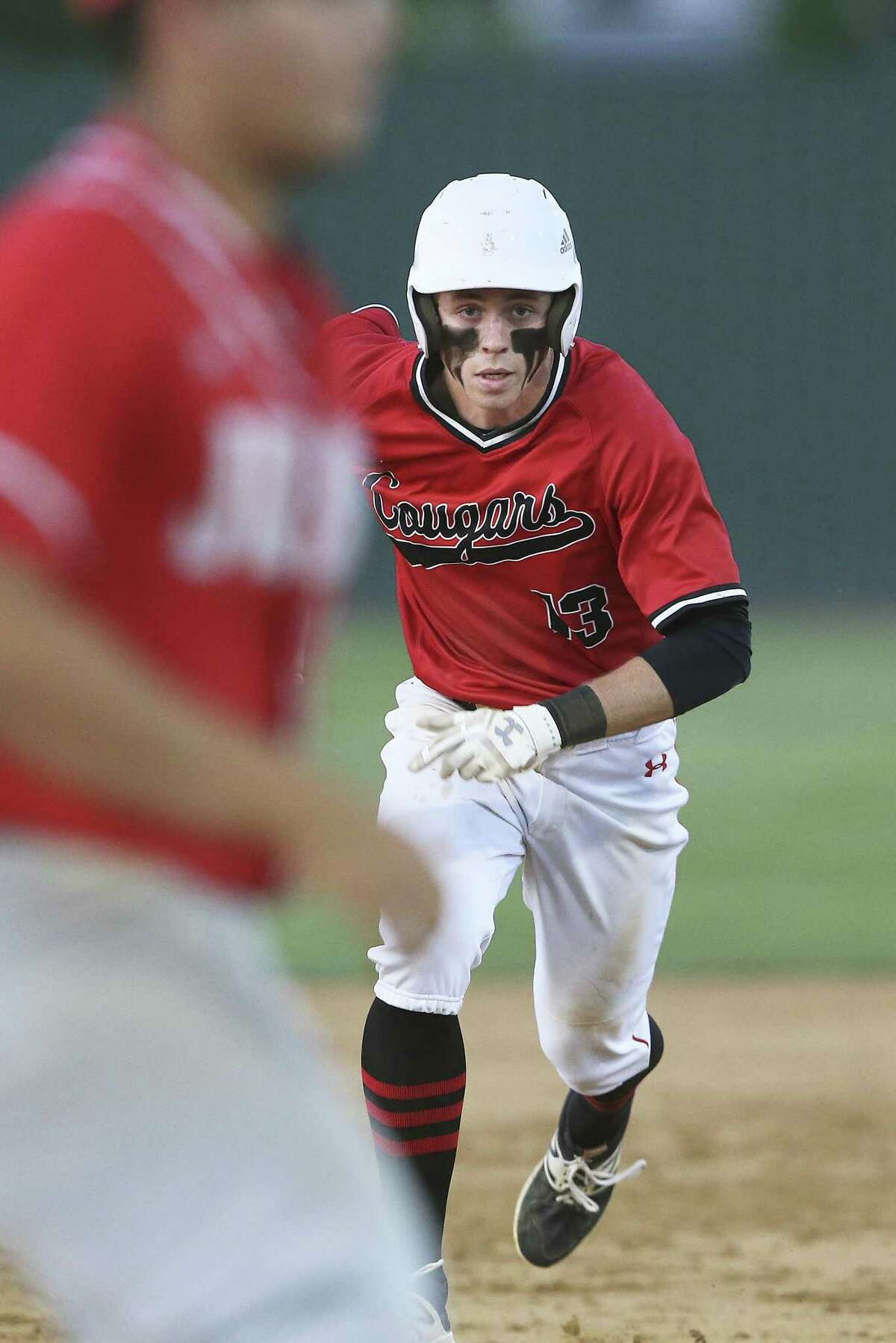 Payne McKay sprints in to steal third base for the Cougars as Canyon hosts Judson in baseball at Canyon High School on April 24, 2018.