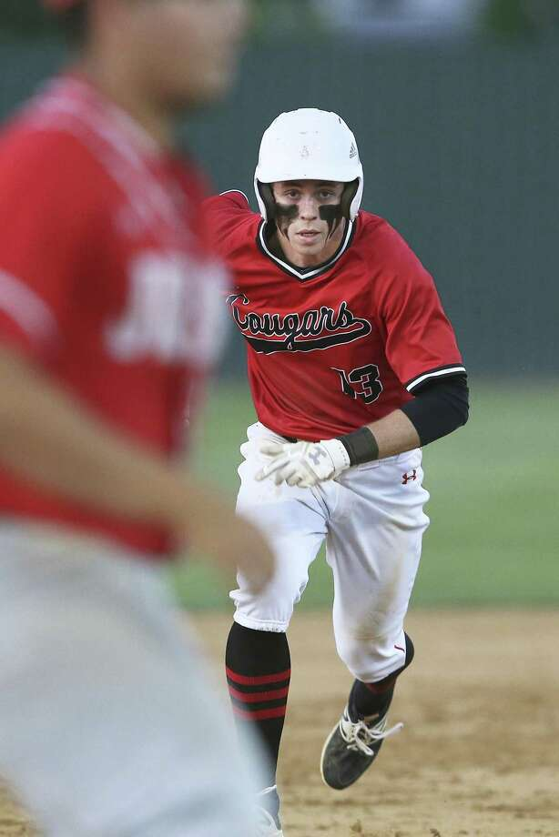 Payne McKay sprints in to steal third base for the Cougars   as Canyon hosts Judson in baseball at Canyon High School on April 24, 2018. Photo: Tom Reel, Staff / San Antonio Express-News / 2017 SAN ANTONIO EXPRESS-NEWS