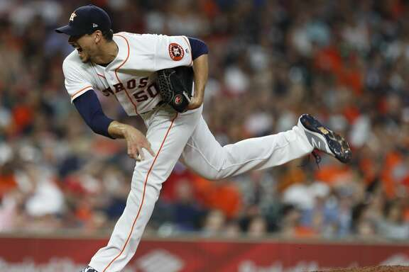 Houston Astros starting pitcher Charlie Morton (50) pitches during the third inning of an MLB game at Minute Maid Park, Tuesday, April 24, 2018, in Houston. ( Karen Warren  / Houston Chronicle )