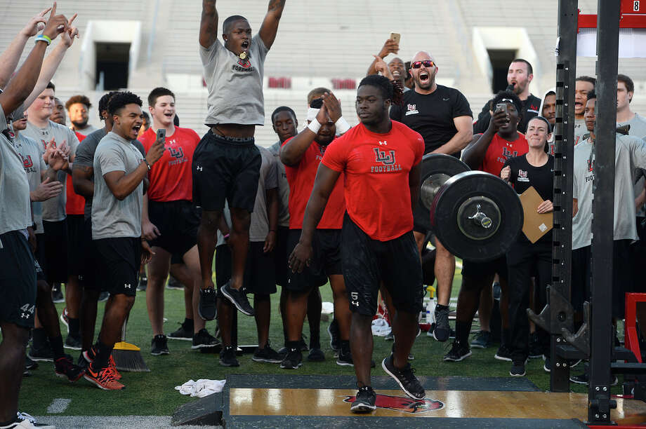 Lamar players and strength coaches cheer as running back Derrion Randle sets a new school record for the position in the clean during the football team's Night of Champions event. The players set several personal and school weightlifting records.   Photo taken Tuesday 4/24/18 Ryan Pelham/The Enterprise Photo: Ryan Pelham, Ryan Pelham/The Enterprise / ©2018 The Beaumont Enterprise/Ryan Pelham