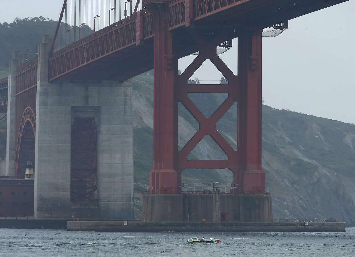 Lia Ditton rows her 21-foot boat under the Golden Gate Bridge in Sausalito, Calif. on Tuesday, April 24, 2018 in an attempt to row around the Farallon Islands. Ditton is hoping to be the first solo rower to circle the Farallones and return in two days.