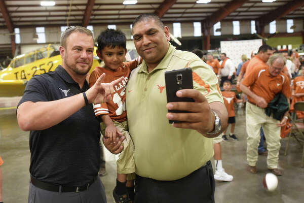 Texas Exes and University of Texas Athletics Department passed through Midland on the This Is Texas Tour featuring athletics program leaders including head football coach Tom Herman, pictured at left, April 24, 2018, at the Commemorative Air Force museum hanger.  James Durbin/Reporter-Telegram