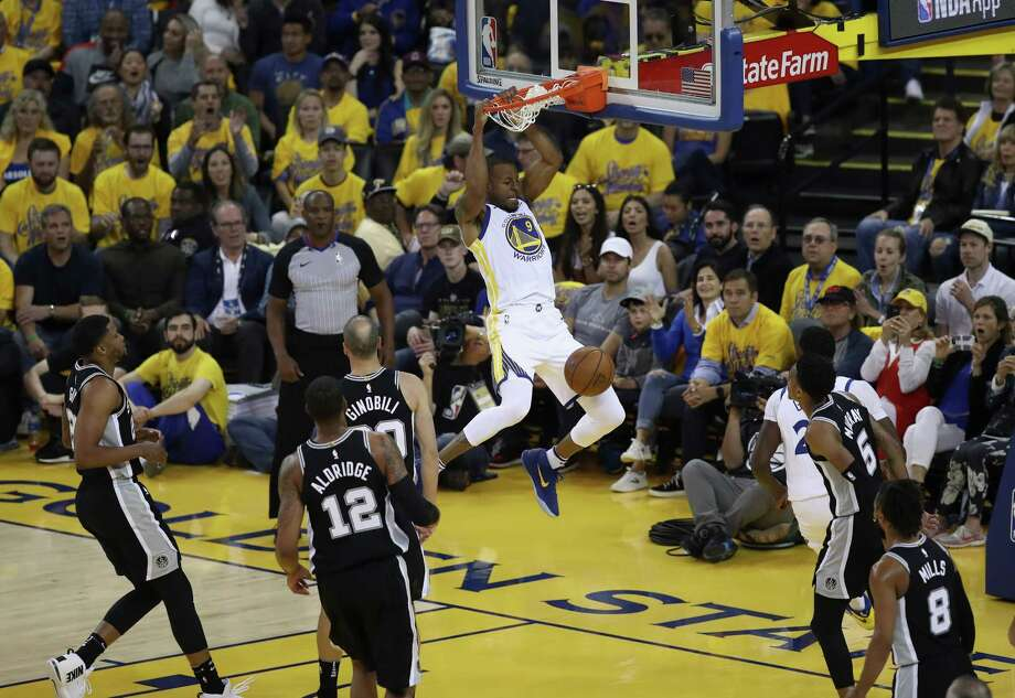 OAKLAND, CA - APRIL 24:  Andre Iguodala #9 of the Golden State Warriors dunks the ball against the San Antonio Spurs during Game Five of Round One of the 2018 NBA Playoffs at ORACLE Arena on April 24, 2018 in Oakland, California.  NOTE TO USER: User expressly acknowledges and agrees that, by downloading and or using this photograph, User is consenting to the terms and conditions of the Getty Images License Agreement. Photo: Ezra Shaw, Getty Images / 2018 Getty Images