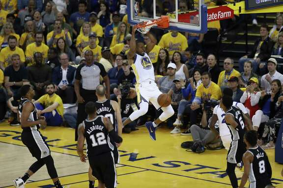 OAKLAND, CA - APRIL 24:  Andre Iguodala #9 of the Golden State Warriors dunks the ball against the San Antonio Spurs during Game Five of Round One of the 2018 NBA Playoffs at ORACLE Arena on April 24, 2018 in Oakland, California.  NOTE TO USER: User expressly acknowledges and agrees that, by downloading and or using this photograph, User is consenting to the terms and conditions of the Getty Images License Agreement.
