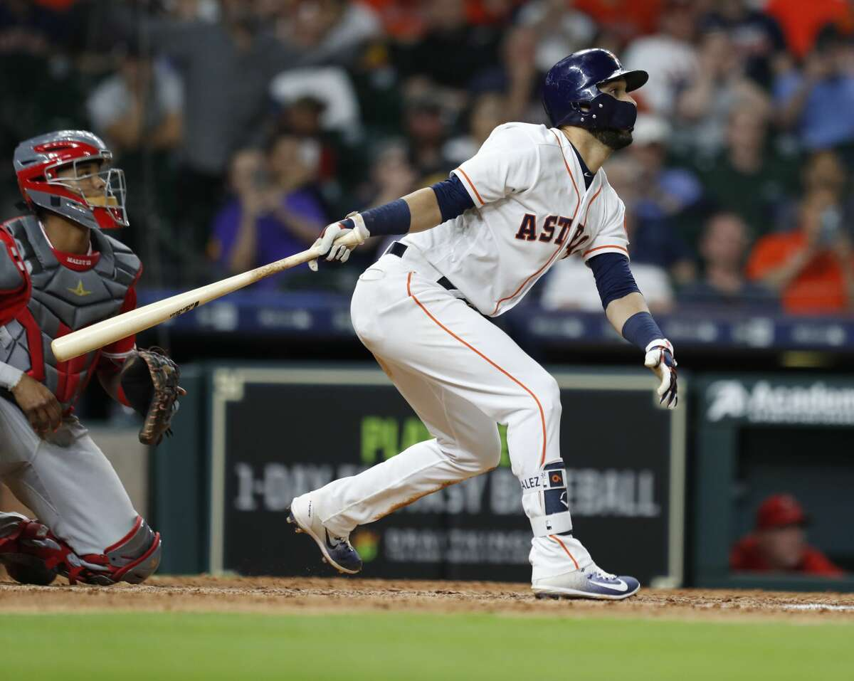 Houston Astros Marwin Gonzalez (9) hits an RBI single during the seventh inning of an MLB game at Minute Maid Park, Tuesday, April 24, 2018, in Houston. ( Karen Warren / Houston Chronicle )