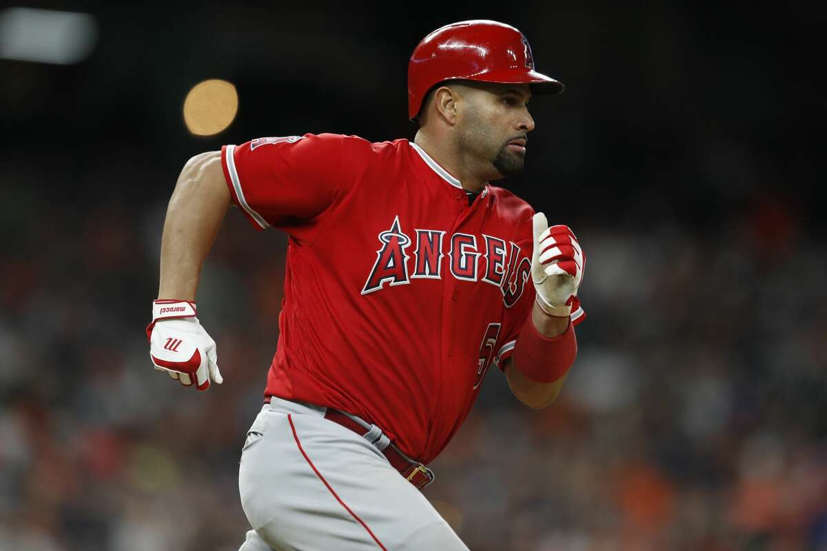 Los Angeles Angels Albert Pujols (5) runs past first base on his way to second on his double during the seventh inning of an MLB game at Minute Maid Park, Tuesday, April 24, 2018, in Houston. ( Karen Warren / Houston Chronicle )