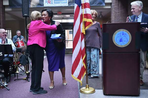 """Frances """"Bitsie"""" Clark hugs Mayor Toni N. Harp as the city of New Haven celebrates its 380th birthday, Tuesday, April 24, 2018, at the first-floor atrium at City Hall at 165 Church Street in New Haven."""