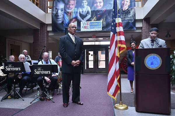 Pastor Donald Morris, center, is honored with the city spirit award as the city of New Haven celebrates its 380th birthday, Tuesday, April 24, 2018, at the first-floor atrium at City Hall at 165 Church Street in New Haven.