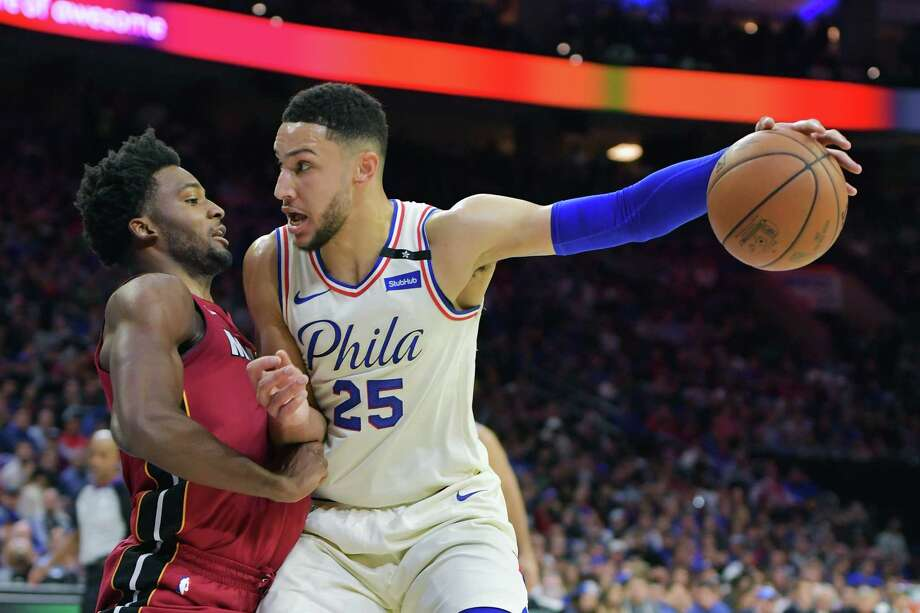 PHILADELPHIA, PA - APRIL 24: Ben Simmons #25 of the Philadelphia 76ers fights off Justise Winslow #20 of the Miami Heat at Wells Fargo Center on April 24, 2018 in Philadelphia, Pennsylvania. (Photo by Drew Hallowell/Getty Images) Photo: Drew Hallowell / 2018 Getty Images