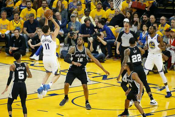 Golden State Warriors' Klay Thompson scores over San Antonio Spurs' LaMarcus Aldridge in the first quarter during game 5 of round 1 of the Western Conference Finals at Oracle Arena on Tuesday, April 24, 2018 in Oakland, Calif.