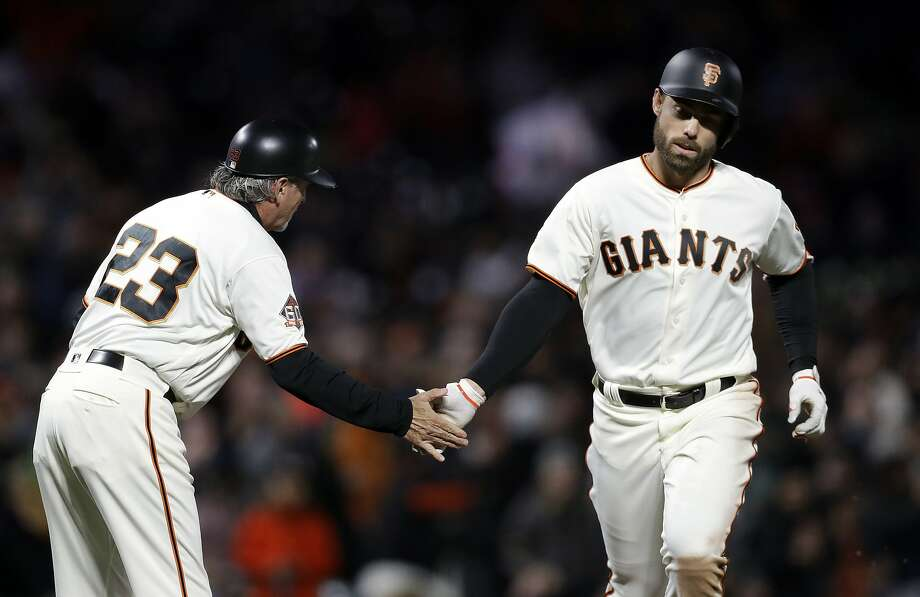 San Francisco Giants' Mac Williamson, right, shakes hands with third base coach Ron Wotus after Williamson's solo home run against the Washington Nationals during the sixth inning of a baseball game Tuesday, April 24, 2018, in San Francisco. (AP Photo/Marcio Jose Sanchez) Photo: Marcio Jose Sanchez / Associated Press