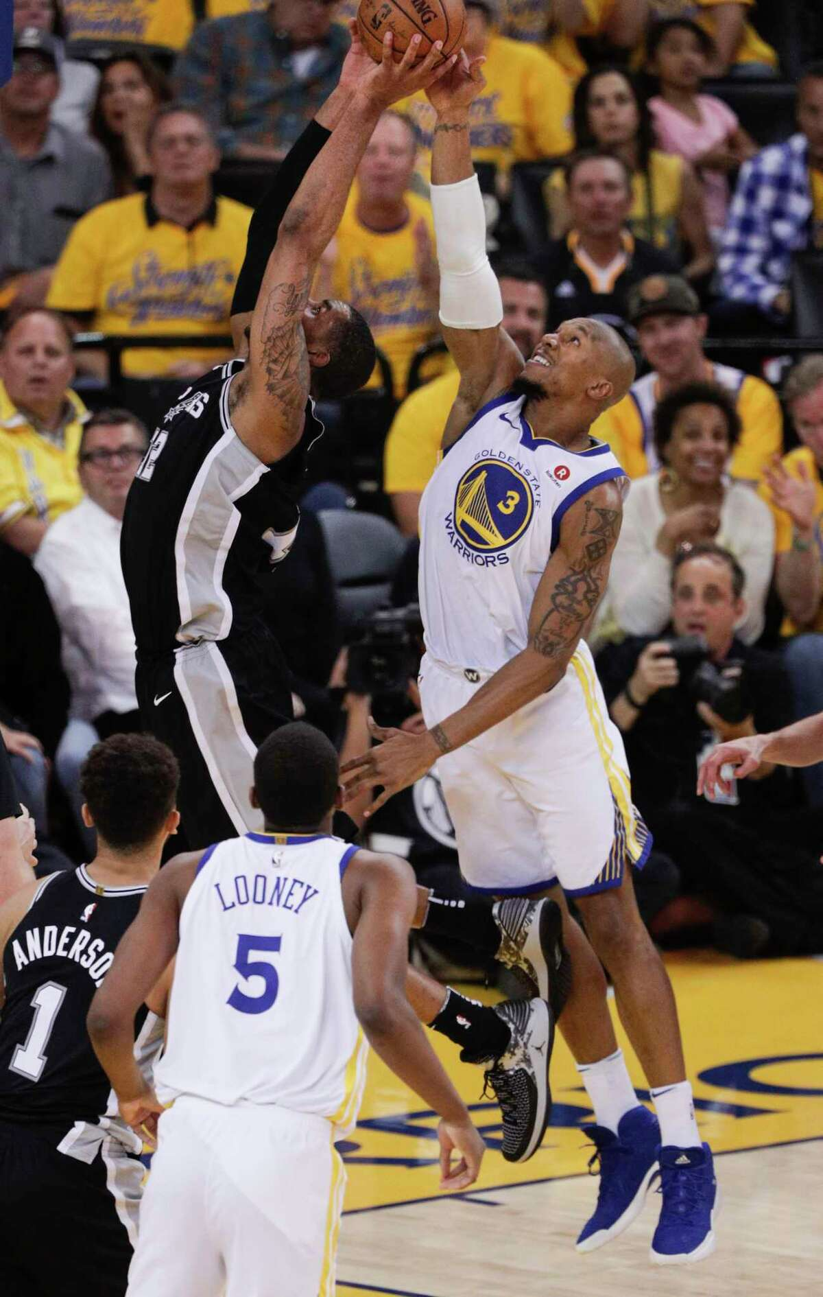 Golden State Warriors' David West blocks a shot by San Antonio Spurs' LaMarcus Aldridge in the first quarter during game 5 of round 1 of the Western Conference Finals at Oracle Arena on Wednesday, April 25, 2018 in Oakland, Calif.