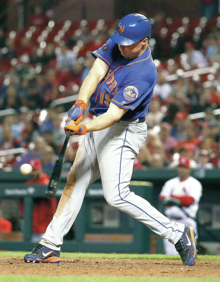 The Mets' Jay Bruce hits a solo home run in the 10th inning of Tuesday night's win over the Cardinals at Busch Stadium. Photo:       AP