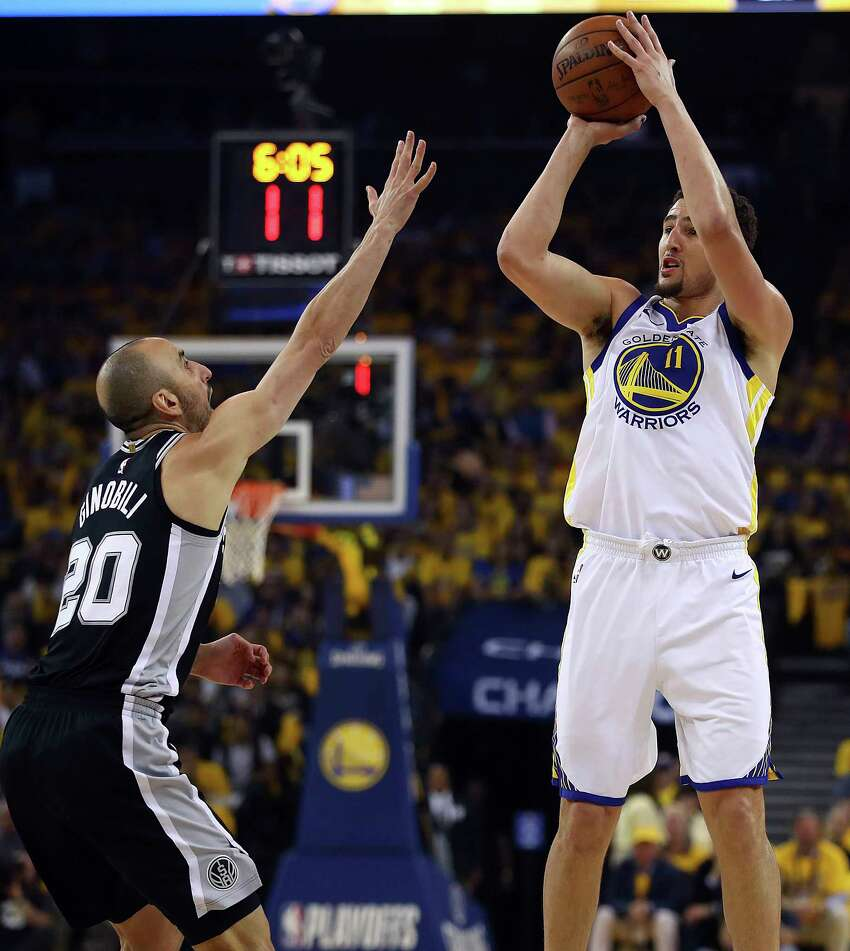Golden State Warriors' Klay Thompson, right, shoots against San Antonio Spurs' Manu Ginobili (20) during the first quarter in Game 5 of a first-round NBA basketball playoff series Tuesday, April 24, 2018, in Oakland, Calif. (AP Photo/Ben Margot)