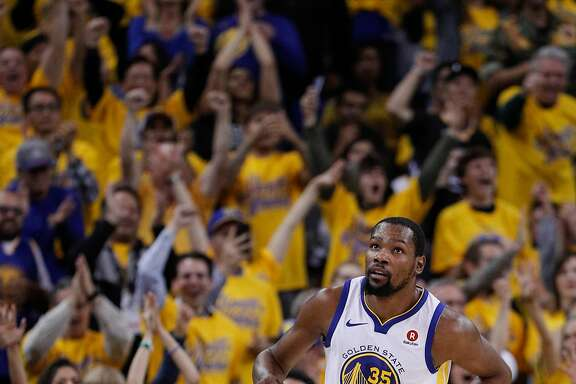 Fans cheer after Golden State Warriors' Kevin Durant dunked in the second quarter during game 5 of round 1 of the Western Conference Finals at Oracle Arena on Tuesday, April 24, 2018 in Oakland, Calif.