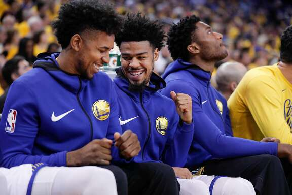 Golden State Warriors' Nick Young and Quinn Cook dance in their seats in the second quarter during game 5 of round 1 of the Western Conference Finals at Oracle Arena on Tuesday, April 24, 2018 in Oakland, Calif.