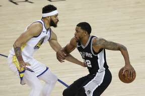 Golden State Warriors' JaVale McGee defends against San Antonio Spurs' Rudy Gay in the first quarter during game 5 of round 1 of the Western Conference Finals at Oracle Arena on Tuesday, April 24, 2018 in Oakland, Calif.