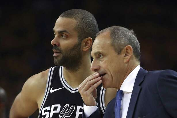 San Antonio Spurs acting coach Ettore Messina, right, speaks with Tony Parker during the first quarter in Game 5 of a first-round NBA basketball playoff series against the Golden State Warriors on Tuesday, April 24, 2018, in Oakland, Calif. (AP Photo/Ben Margot)