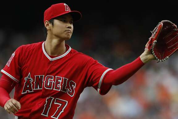 Los Angeles Angels starting pitcher Shohei Ohtani between pitches during the first inning of an MLB game at Minute Maid Park, Tuesday, April 24, 2018, in Houston. ( Karen Warren  / Houston Chronicle )