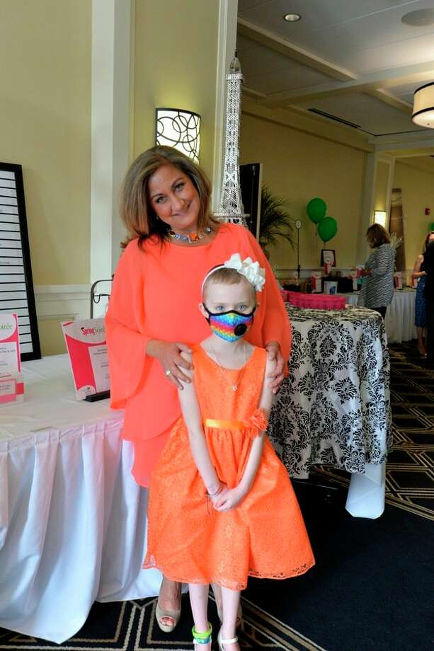 Alison Andres, a 7-year-old leukemia survivor, stole the dance floor at the Cancer Services Spring Soiree. She poses here with Julie Nunn, executive director of Cancer Services. (Photo provided) / Robert Spears