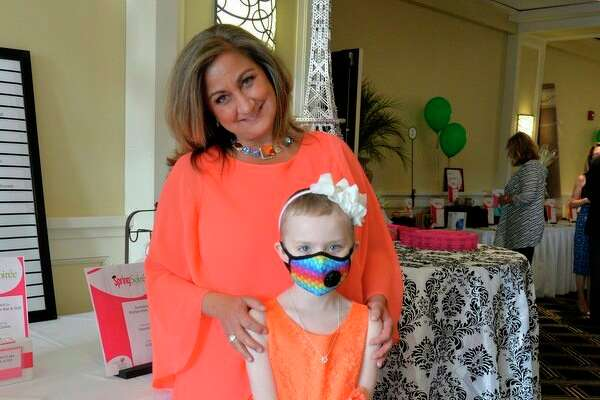 Alison Andres, a 7-year-old leukemia survivor, stole the dance floor at the Cancer Services Spring Soiree. She poses here with Julie Nunn, executive director of Cancer Services. (Photo provided)
