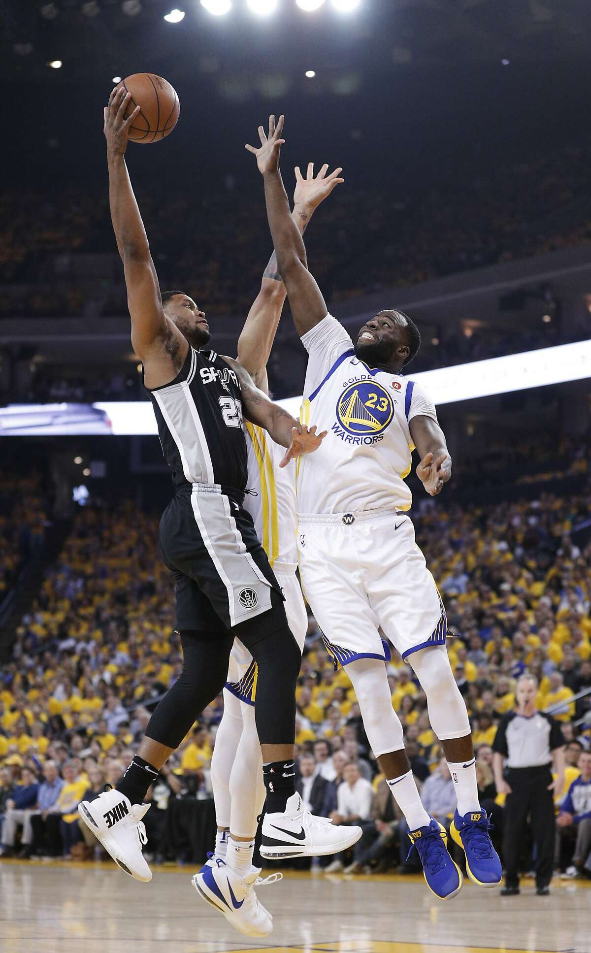 Golden State Warriors' Draymond Green defends against San Antonio Spurs' Rudy Gay in the first quarter during game 5 of round 1 of the Western Conference Finals at Oracle Arena on Tuesday, April 24, 2018 in Oakland, Calif.