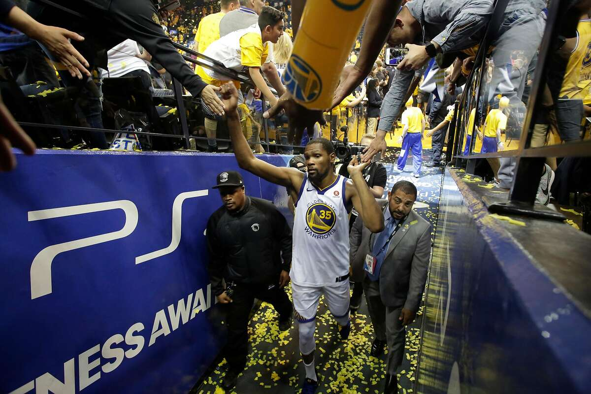 Warriors' Kevin Durant, 35 is congratulated by fans as he exit the court as the Golden State Warriors beat the the San Antonio Spurs 99-91 in game 5 in the first round of the Western Conference Finals in NBA playoffs in Oakland Calif. on Tues. April 24, 2018.